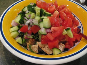 tomatoes, cucumber, onion and bread cubes