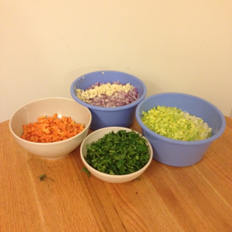 diced carrots, leeks, onions, minced garlic and chopped parsley